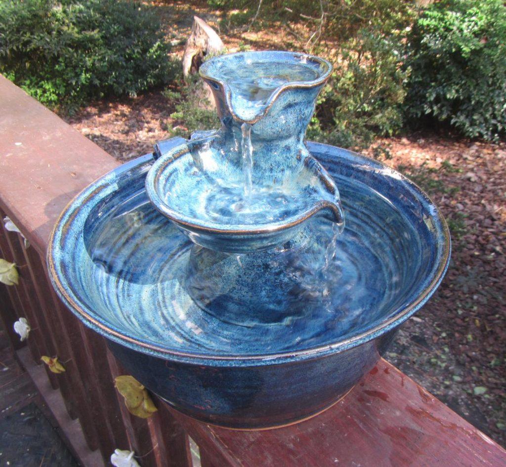 ceramic dog drinking fountain